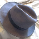 Beloved first Bouchercon fedora! Plain gray felt, inexpensive.